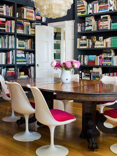 Black shelving victorian table and Eero Saarinen Tulip chairs