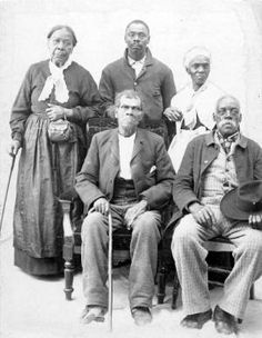 This group of fugitive slaves escaped to freedom in Canada on the Underground Railroad and took up residence in Windsor, Ontario, Canada. Their names are listed from left to right as, back row: Mrs. Hunt, Mansfield Smith, Mrs. Seymour; front row: Stevenson, Johnson.