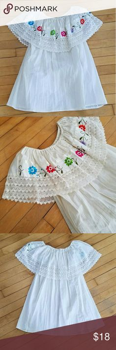 """Mexican Embroidered Peasant Shirt Mexican Embroidered Peasant Shirt. New with tags. Can be worn on or off shoulder. One size fits most. 23"""" from arm pit to arm pit, 24"""" long from front of top top hem.  Boho free people pueblo hippie Tops"""