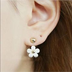 2 in 1 Earrings Cute while flower earrings. These can be worn with or without the flower. Zinc alloy metal. New in package. Jewelry Earrings