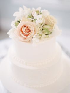 Elegant floral-topped cake: http://www.stylemepretty.com/north-carolina-weddings/pittsboro/2015/09/04/summer-garden-wedding-at-fearrington-house/ | Photography: Marcie Meredith - http://marciemeredith.com/