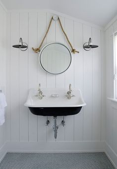 Threshold Interiors took a beautiful Nantucket, MA beach house and turned it into an elegant re...