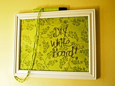 DIY White Board :)    picture frame + fabric + mod podge + yarn and a dry-erase marker.
