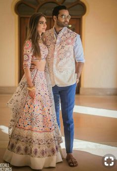 The white lehenga looks beautiful with the bright multicoloured floral prints. The lehenga looks simple yet elegant and apt for any of your wedding ceremonies.