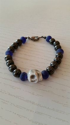 Check out this item in my Etsy shop https://www.etsy.com/listing/249861016/grey-skull-blue-glass-magnetic-beaded