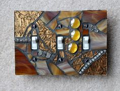 Golden Glamour - Handmade Triple Mosaic Light Switch Cover Wall Plate. $23.95, via Etsy.