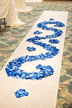 Blue Rose Petal Wedding Ceremony Aisle  For all the details, check out http://www.weddinggirl.ca/blog/2013/03/18/royal-blue-gold-wedding-port-credit-mississauga/