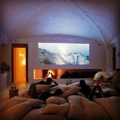love the idea of a hug bed with tons of pillows rather that the individual chairs. And love the fire place!