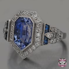 Antique Art Deco sapphire and diamond engagement ring. ~~ Interesting, unusual shape