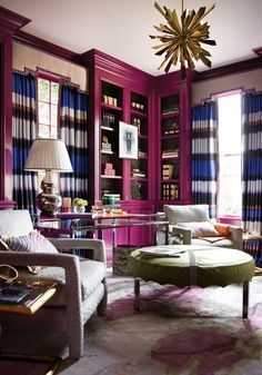 Love the bookcases...how fun...love fuschia (magenta) paired with navy & royal blues, and gold....fun way to punch up a traditional interior!