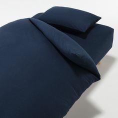 布団カバーは無印良品さんのもの。 敷き布団、掛け布団、枕、のセットがすっぽり入りました。