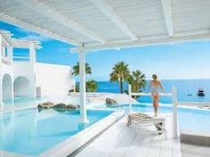 luxury hotel with beautiful blue water.