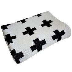 (http://www.spearmintlove.com/eco-cross-blanket-cream-black/)