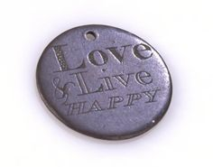 Love Token - 'TS', 'Love & Live Happy', Great Britain, circa 1800. Love tokens were often commissioned by convicts before they were transported to Australia, as a memento for their loved ones. Itinerant engravers visited the prisons and hulks, finding a ready market for these tokens, which were made to order from smoothed-down coins. Victoria Museum.
