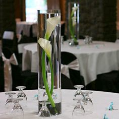 White Calla Lily in vases for mantel... www.myfloweraffair.com can create this for your wedding.