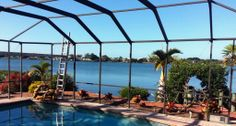 Pool cage repainting in Sarasota Bay.