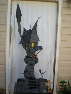 A Nightmare Before Christmas house sculpture  by THE HAUNTED CONSTRUCTION CO.