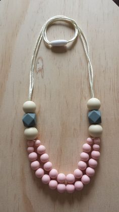 Hey, I found this really awesome Etsy listing at https://www.etsy.com/listing/228496087/silicone-teething-necklace-poppy-in-pink