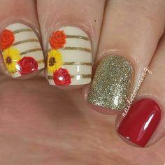 Such a cute Fall look! I love the flowers! #FlowerNails #NailArt #Manicure #FallNails