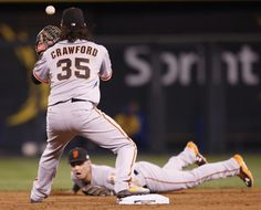 The best photos of the 2014 San Francisco Giants - The amazing flip from Panik to Crawford to make the double play in Game 7.