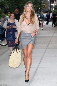 Catwalker: Heidi Klum looked ready for the runway herself as she sashayed down a sidewalk in New York City on Thursday