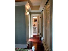 hallway of remodeled double wide-chunky crown on vaulted ceilings carried around straight
