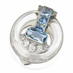 Aquamarine, Rock Crystal and Diamond Clip-Brooch, Cartier, Circa 1930. The rock crystal ring surmounted by emerald-cut and square mixed-cut aquamarines weighing approximately 3.35 carats, accented by old European-cut and single-cut diamonds weighing approximately .90 carat, mounted in platinum and white gold, signed Cartier, numbered 3440.