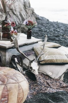 Bohemian picnic on the sand with the sound of the waves crashing upon the shore.