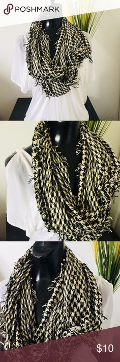 Black and white scarf Black and white patterned scarf. Edges are frayed (it came that way!). Is not a unity style scarf, but you can tie the ends together and wear it that way. Very cute and trendy! Accessories Scarves & Wraps