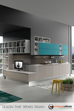Light grey and matte lacquer turquoise cabinets from the Bijou collection by Aran Cucine.