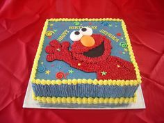 Ribbon cake with butter cream icing. Elmo was traced on...