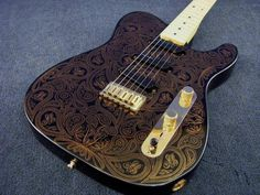 Rock band has corrupted me.  Once I am done school I think I will take up the guitar.  I am now saving for this 2004 Fender James Burton Telecaster Gold Paisley Electric Guitar.