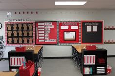 Love this look. It is so important to stick with a few colors. the bulletin boards look great. I also like the bookcases at the ends of the desks.