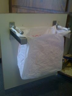 Ikea Hack... shelf brackets & cabinet knobs turned into undersink garbage container. UPCYCLE! :)