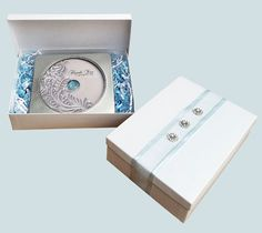 """Keepsake CD in a Gift Box  Introducing """"Thank You for giving this day""""     a newly released song that honors and pays tribute to your parents on your wedding day. Through this song, a lifetime of memories are transformed into a moment that will deeply move your parents, as well as your guest.        Contains CD in a Tin case packaged in a white swirl gift box with crinkle paper and  embellished ribbon"""