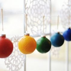 Recycle old ornaments to make these colorful bulbs that look like they're made of paper.