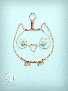 Owl Pendant - necklace hand made with copper wire and teal beads - artsy owl ornament. $10.50, via Etsy.