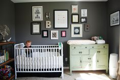 Eclectic Gallery Wall over Crib in Nursery