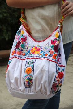 White and multi colored hand Embroidered Huipil Boho by CasaOtomi, Mexico… Mexican Fashion, Mexican Style, Bags Online Shopping, Online Bags, Mexican Embroidery, Embroidery Ideas, Mexican Dresses, Embroidered Bag, Boho Bags