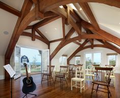 Curved bottom chords mimic the space created by gambrel roof of this oceanside home studio on Cape Cod. Photo by Ed Wonsek