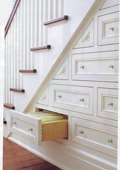 Drawers under the stairs.