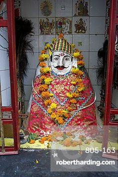 Hindu street shrine, decorated with marigold mala (garlands) for Diwali festival, Udaipur, Rajasthan, India, Asia