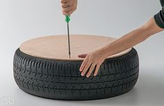 Use your screws to secure the wood to the tire. Repeat the same on the other side of the tire as well.