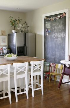 I want a chalkboard like this somewhere with the photo bunting as a place to list prayer requests.
