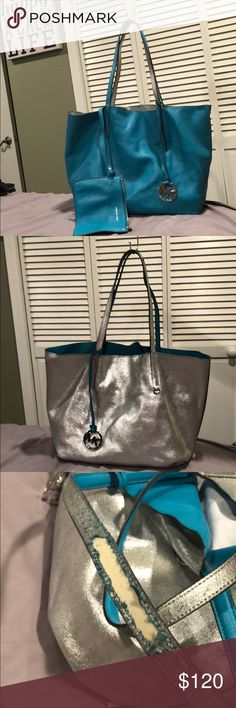 Michael Kors reversible purse w/wristlet Nice looking tote purse w/wristlet. Silver side strap is peeling off in one section (see pictures) Michael Kors Bags Totes