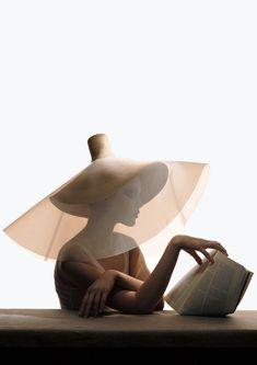 Yohji Yamamoto straw hat with clear plastic overlay. VOGUE, 2004