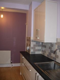 The dark worktops really add to the sleek lines.  http://www.ppmsltd.co.uk