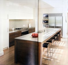 Timber island, white benchtops. A great example of avoiding a benchtop waterfall.