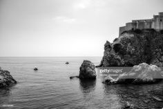 View top-quality stock photos of Scenic View Of Rocks In Sea Against Sky. Find premium, high-resolution stock photography at Getty Images. Dubrovnik, Royalty Free Images, Croatia, Sky, Stock Photos, Black And White, Water, Rocks, Photography