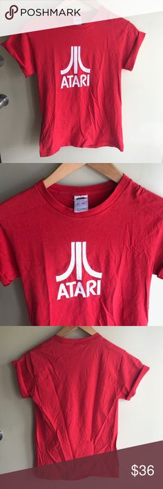 🕹 VINTAGE • Bright red Atari game system t-shirt 🕹 BRIGHT RED ATARI GAME SYSTEM T-SHIRT || sz Medium --- • great used vintage condition; no rips or stains. no fading and a bit of cracking from wear and wash. • bright red in color • everyone remembers Atari!  --- #vintagetee #vintagetshirt #vintage #vtg #retro #atari #nintendo #vintagefashion #gamesystem #classic Vintage Tops Tees - Short Sleeve